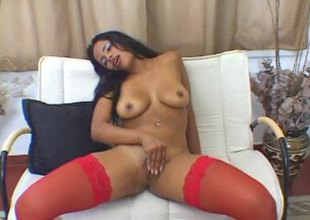Off colour red stockings on this naughty masturbating black girl