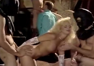This sex frenzied blonde loves being encircling the middle of a spitroast