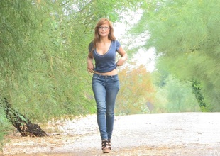 Redhead honey in glasses and jeans love to flaunt her nice butt and natural heart of hearts in public