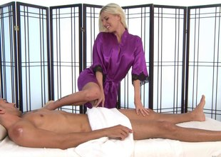 Busty blonde takes off her silk robe and sucks a dude's hard cock