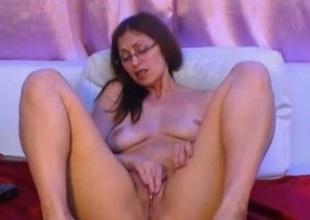 Big-assed milf in glasses fingers her cooch in webcam exclusively show