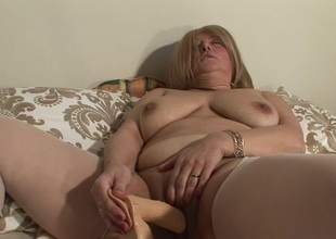 Right away she's alone, this mature slut loves to play with toys