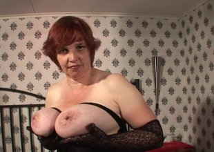 Large titted mama playing with her pussy