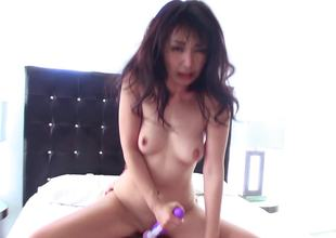A chick uses a vibrator on her pussy and on a large dick also