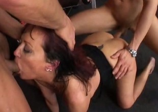 In the gym, a horny mature woman gets pounded hard by 2 juvenile chaps
