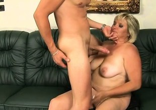 Chunky aged woman Kokai gives a young stud a sloppy blowjob