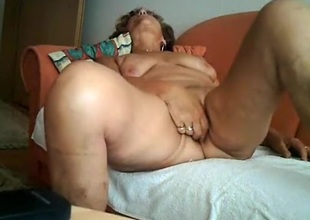 Gilf masturbates with a vibrator and rides elder man in the first place the sofa