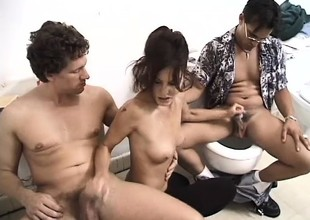 Slutty milf has 2 horny studs roughly banging her holes more the toilet