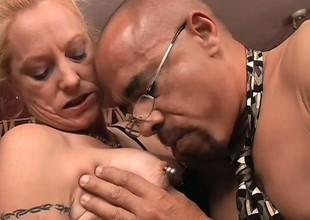 Ravishing mature woman with nipple piercing has flagitious interracial banging