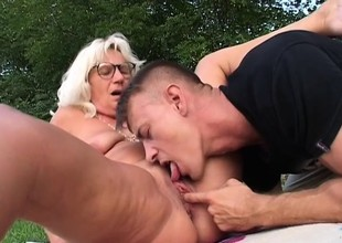 Excited granny is understood to fucking younger guys with stiff dicks