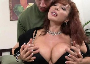 Mature redhead in all directions a grown pair of knockers gets a shafting
