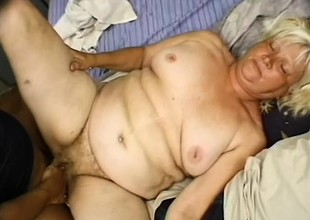 Old slut receives her worn-out cunt penetrated at the end of one's tether young famished stud