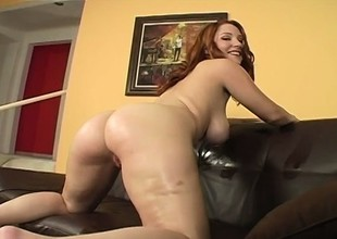 Oiling redhead's enormous boobies connected with previous to an intense pussy plowing