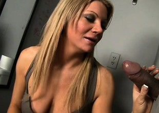Breasty blond milf with a spicy ass Christina Skye worships a large flannel at the gloryhole