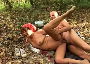Horny granny sucks a big dick and enjoys a firm pounding in the forest