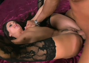 Banging hot pitch-dark babe in stockings receives stuffed away from a stud