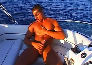 Fernando Nielsen is enjoying a fully nude masturbation as this 8 minute outdoor scene fades into view.  He's beyond everything a boat adjacent to the middle of the lake beyond everything a blue sky day, and rubbing his hands over his nipples and muscles, clearly not a guardianship adjacent to the world.  True