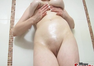 Yummy big natural tits coated in slippery oil