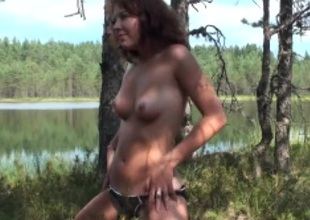 Amateur suitor in a swimsuit strips unconnected with the lake