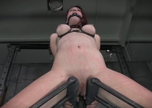 Bound redhead has whip marks adjacent to her body