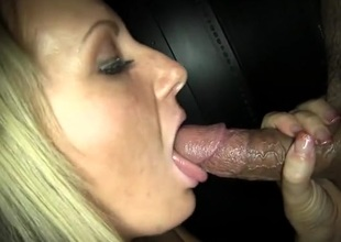 Gloryhole cocksucker swallows cum from strangers
