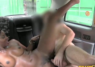 Charming pitch-black girl fucked in a taxi cab
