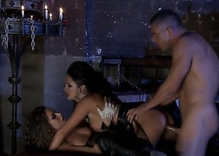 Alektra Blue and Tori Black are in a threesome with a coxcomb in a dungeon turn this way is only lit overwrought candles. They are doing some servitude in this sexy and amazing scene.