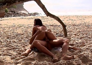 Awesome Brazilian bitch is ready for some freaky action with her boyfriend in the first place the beach. Long haired slut with a natural company enjoys getting her both holes drilled with a big dick. Brazilian porn is the best!