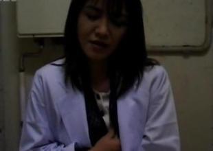 Yuko Tachibana uses vibrator atop pussy atop WC