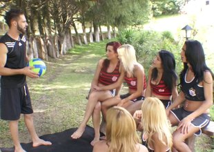 Spunky shorts-clad tranny with long blonde hair enjoying a mind-blowing gangbang
