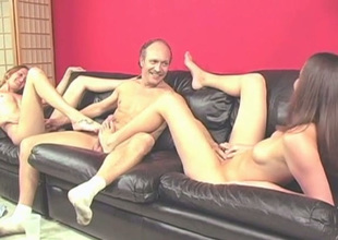 Older dude receives teased almost a fine footjob performed by leggy brunette
