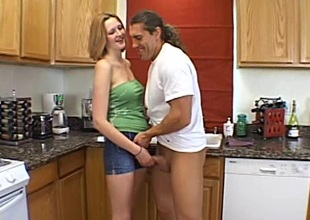 Diminutive mediocre babe with natural jugs milking a horseshit in the kitchen