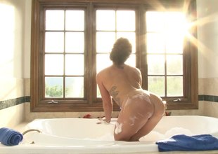 A red hot blonde strips off her lingerie and takes a bubble bath