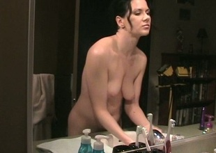 Flirty brunette enjoys a solo masturbation shoot in the baths
