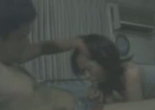 Cum craving Thai chick gives her boyfriend a nice blowjob at home