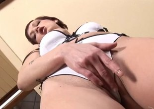 Short haired redhead masturbating with a Herculean dildo close up