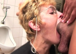 Voluptuous blonde mature slut sucking load of shit on the toilet