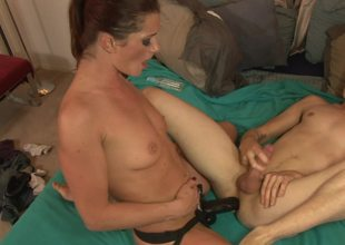 Cici Rhodes pegs him in the ass with her big darksome cock