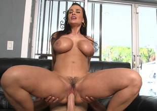 Lisa Ann is filmed as she rides a guys dick like a cowgirl here