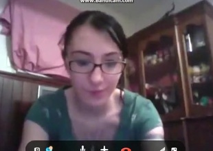 Nerdy girl at hand glasses masturbates at hand a trifle for her bf on skype