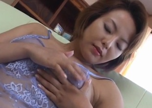 Rio Kurusu puts vibrator on her hairy crack under lace