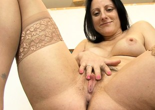 Chubby brunette MILF rubs her hairy cunt roughly a toy forth her office