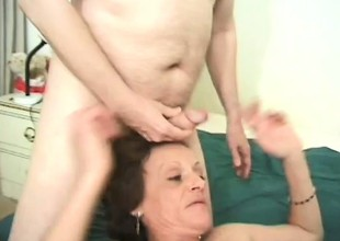 Horny granny grabs two thick pricks and works in all directions her indiscretion
