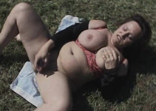 Fat old bitch uses a huge dildo to pine her aged wet chink outdoors