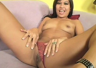 Asian cutie Max fingers her twat, gives a nice blowjob together with gets nailed hard on the sofa
