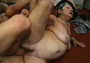 Horny heavy granny loves younger men who stand up her disposed to a stallion
