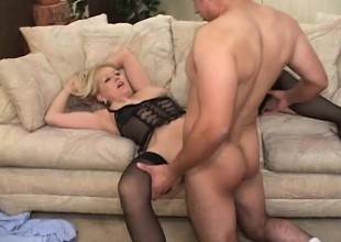 Breasty blonde cougar in darksome lingerie takes a young blarney for a ride