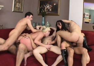 A room full of cocks goes after two sultry bitches in a hot gangbang