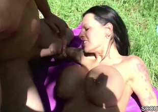 German Monster Tit MILF get be crazy Outdoor wide of two Young Boys