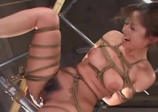 Sexy Japanese woman is rope fastened with her hands tied behind her. That babe straddles a vibrator and he gets her off endlessly. 2 men then enjoy her pleasure with multiple sex-toys placed down her tits and pussy. That babe drools and orgasms multiple times.